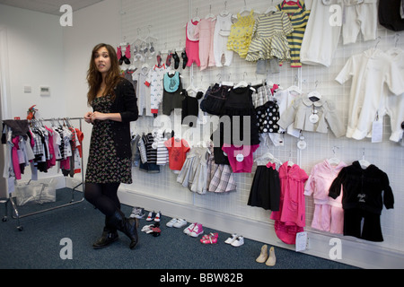 """Personality Myleene Klass during promo filming before launch of her own """"Baby K"""" collection at Mothercare's UK HQ. - Stock Photo"""