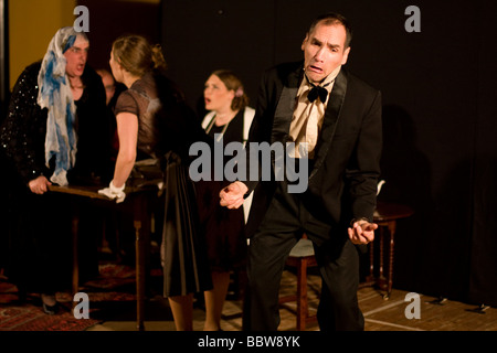 Amateur actors in evening dress express strong emotions - Stock Photo