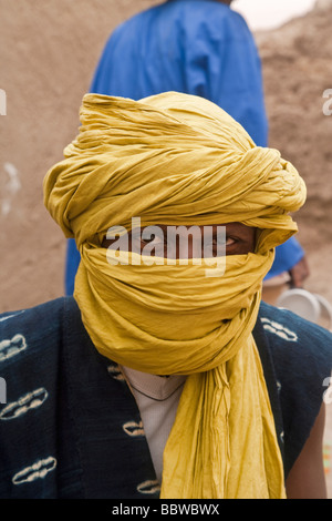 Africa West Africa Mali Segou Woman outside Mud Mosque in Segoukoro old Segou - Stock Photo