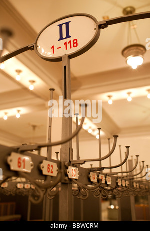 Enamel signs of a theater s cloakroom - Stock Photo