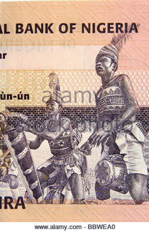 Nkpokiti Drummers from the South Eastern part of Nigeria depicted on a five Naira note dating from 2006 - Stock Photo