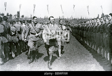 HITLER inspects some of the 60 000 members of the Hitler Youth who attended the Nuremberg Rally in September 1934 - Stock Photo