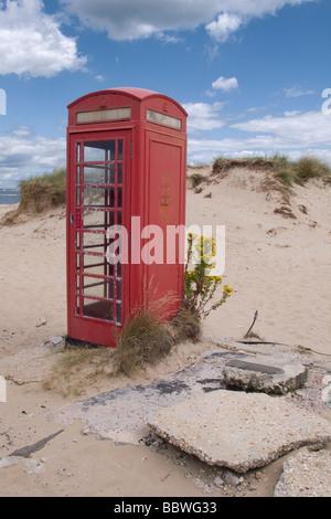 British red telephone box and sand dunes Sandbanks, Dorset, United Kingdom - Stock Photo