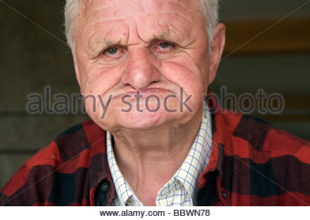 face of elderly 80 plus years man without teeth - Stock Photo