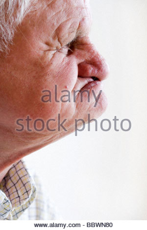 portrait of an elderly man without teeth - Stock Photo