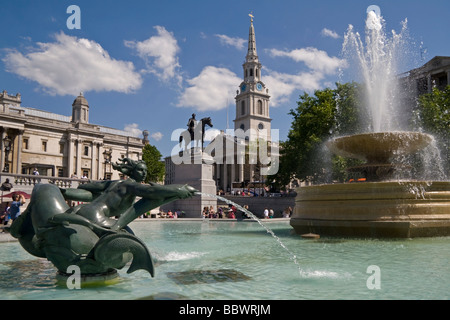 Fountains at Trafalgar Square with St Martin in the Field Church London UK - Stock Photo