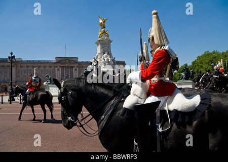 Horse Guards in Trooping The Colour Buckingham Palace London UK - Stock Photo