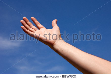 Hand reaching up towards the sky - Stock Photo