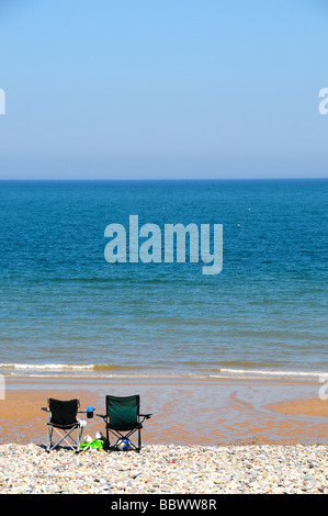 Empty chairs on beach at Llandudno, North Wales, UK - Stock Photo