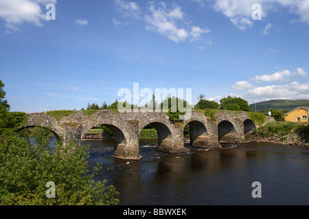 old arched stone bridge over the river strule in newtownstewart county tyrone northern ireland - Stock Photo