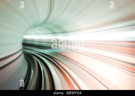 Abstract train tunnel view in high speed. Photo looking in front of a moving train at Kuala Lumpur, Malaysia. - Stock Photo