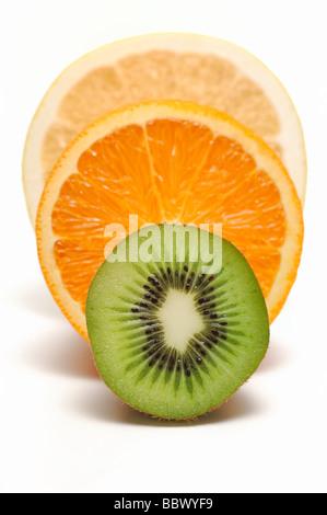 Half Cut of Kiwi Fruit, Orange and Grapefruit - Stock Photo