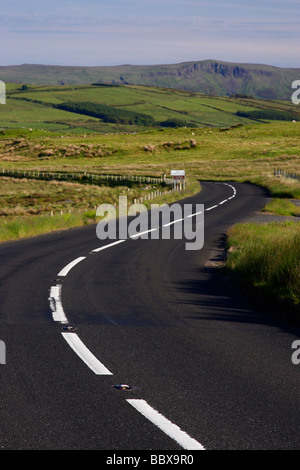 twisty bendy antrim coastal road route over mountains on the antrim plateau county antrim northern ireland uk - Stock Photo