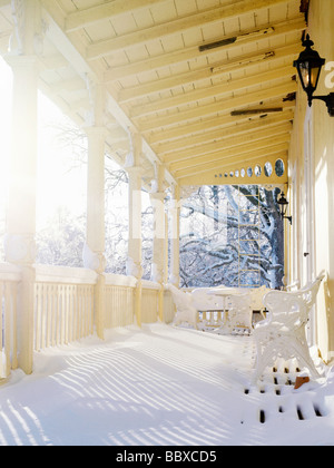 A veranda on a manor house in the winter Sweden. - Stock Photo