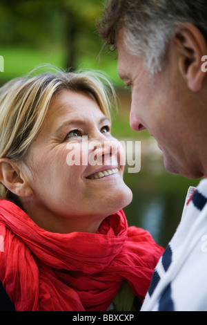 A tender couple strolling in the park Sweden. - Stock Photo