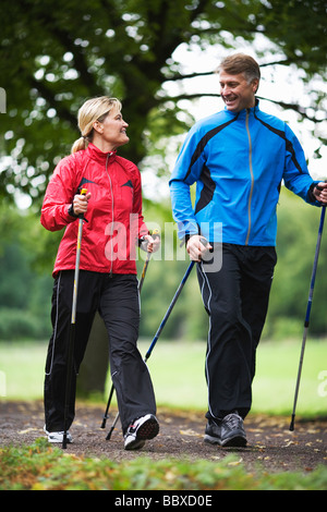 A couple power walking in a park Sweden. - Stock Photo