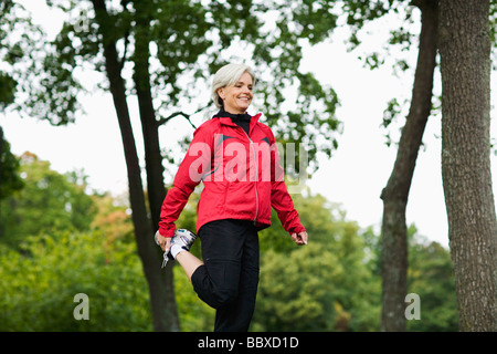 A woman doing stretching exercises Stockholm Sweden. - Stock Photo