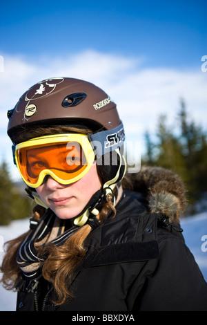 A girl wearing ski goggles Sweden. - Stock Photo