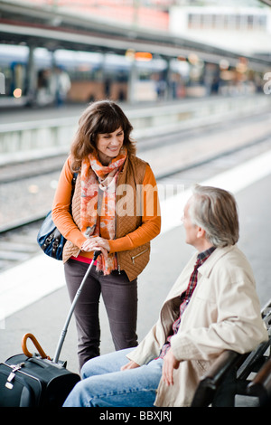 A man and woman on a platform at a railway station Sweden. - Stock Photo