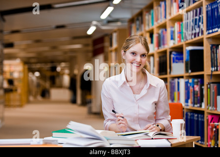 A female student studying in a library Sweden. - Stock Photo