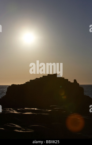 sun setting over the giants causeway county antrim coast northern ireland uk europe - Stock Photo