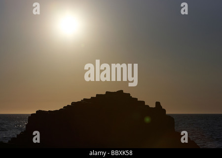 sun setting over the giants causeway county antrim coast northern ireland uk europe - Stock Photo
