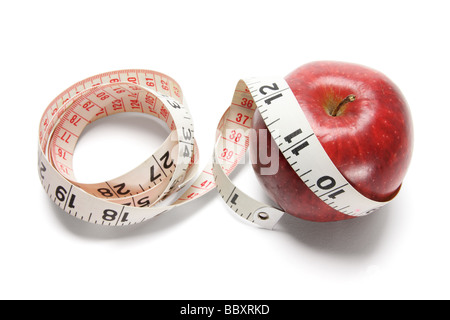 Tape Measure and Red Apple - Stock Photo
