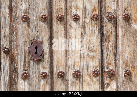 Detail of weathered door with keyhole - Stock Photo
