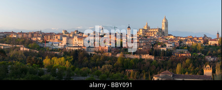Segovia castle and Cathedral surounded by snow capped mountains, Segovia, Spain - Stock Photo