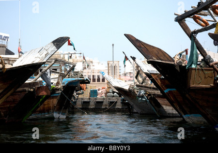 Arab traditional dhows still pack Dubai's creek in 2009 though none any more makes the classic voyage to Africa - Stock Photo