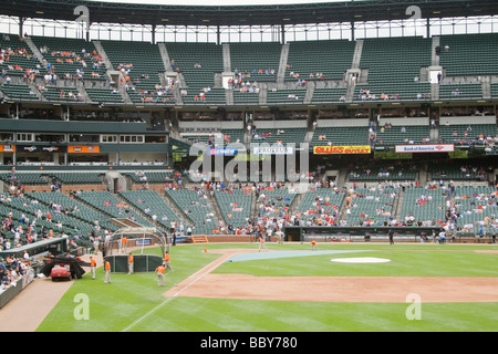 Grounds crew prepare baseball field for play at Oriole Park - Camden Yards Baltimore Maryland - Stock Photo