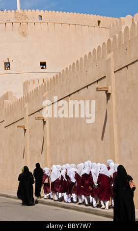 Schoolgirls in front of the Nizwa fort Sultanate of Oman - Stock Photo