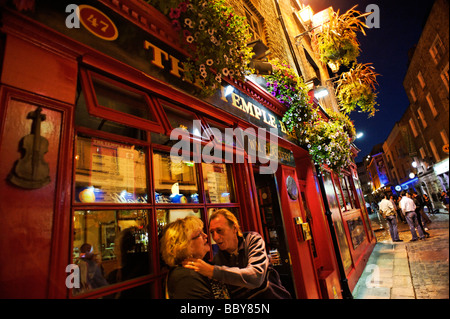 People on a night out outside the Temple Bar pub Dublin Republic of Ireland - Stock Photo
