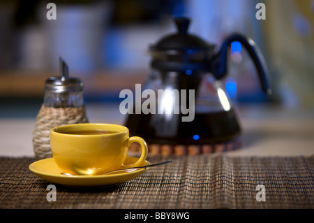 Tea in yellow cup on table - Stock Photo