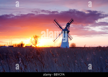Dramatic sunset at Thurne Mill on the Norfolk Broads - Stock Photo