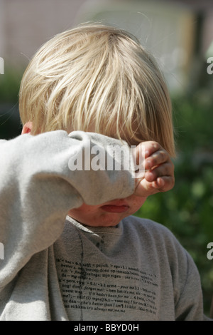 Disappointed little boy having a toddler tantrum - Stock Photo