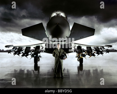 Euro-fighter jet plane and pilot on runway under stormy sky - Stock Photo
