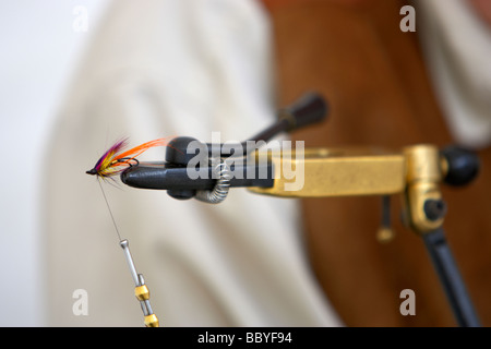 fly tying with fly in vice - Stock Photo