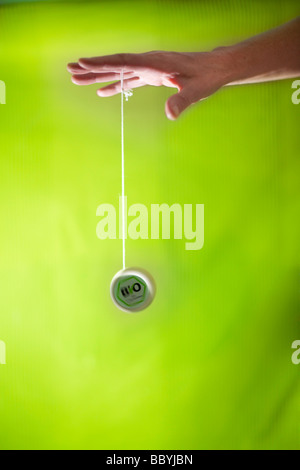 Hand playing with yoyo - Stock Photo