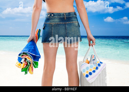 rear view of caucasian woman going to beach. - Stock Photo