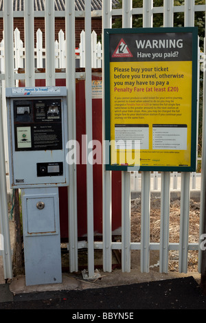 Permit to Travel Ticket Machine and Penalty Warning Notice, - Stock Photo