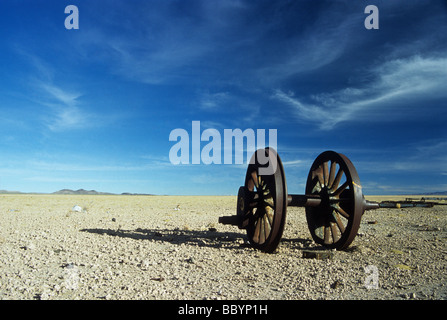 The end of the line - abandoned wheel in train cemetery at Uyuni, Bolivia - Stock Photo