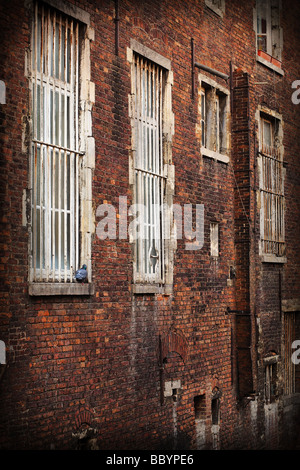 Weathered cracked red brick wall of old building - Stock Photo