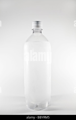 Clear plastic bottle with water on white background - Stock Photo
