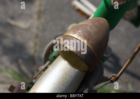 Old rusty bicycle front lamp, Italy. - Stock Photo