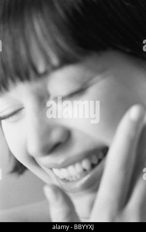 Close up of young woman laughing - Stock Photo