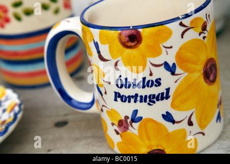 yellow mug Obidos Portugal - Stock Photo