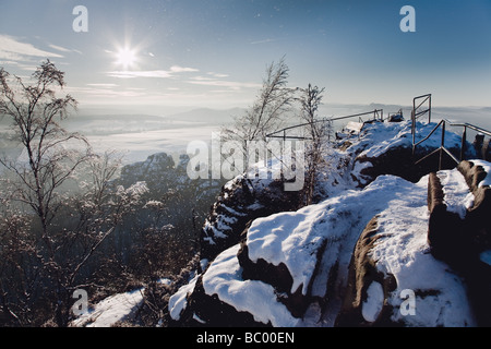 Panoramic view from Schrammsteine into the beautiful winter scenery in national park of Sächsische Schweiz, Germany - Stock Photo
