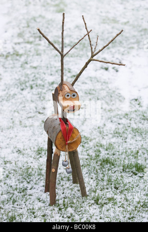 Home made wooden reindeer in the snow - Stock Photo