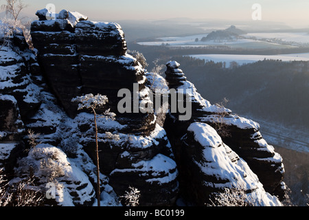 "Panoramic view from Schrammsteine in national park 'Sächsische Schweiz"", Germany, into the beautiful winter scenery - Stock Photo"